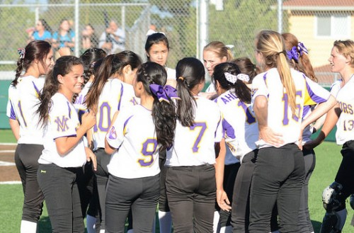 The team huddles between innings on March 25. MVHS defeated Mission San Jose High School 10-0 in five innings. Photo by Pranav Iyer