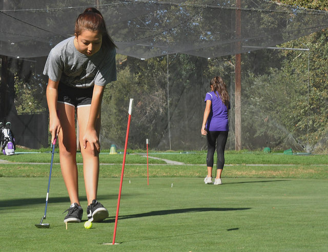 Sophomore Stacy Park looks at the placement of the ball before putting. Park was one of two new players added to the team.