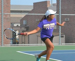 Freshman Leslie Ligier competes in a varsity tennis match. Ligier, one of three MVHS freshmen on the varsity team, is a nationally ranked tennis player.
