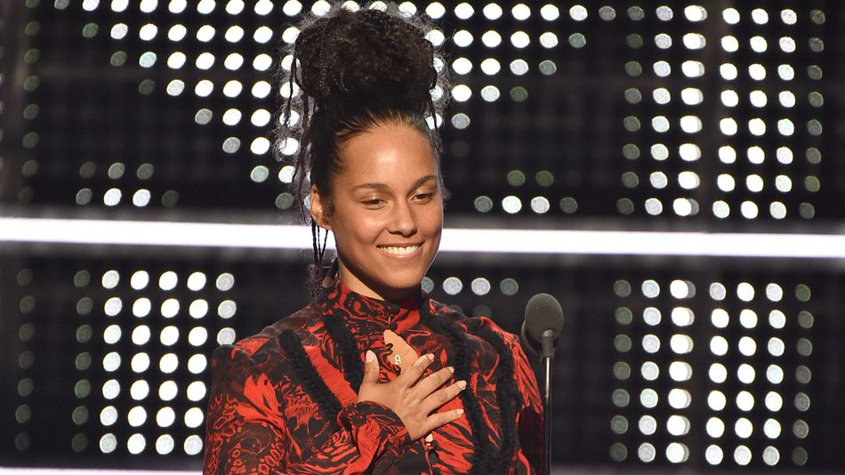"""Alicia Keys giving a heartfelt speech on the anniversary of Martin Luther King's """"I Have a Dream"""" speech. IMAGE: THEO WARGO/MTV/GETTY"""