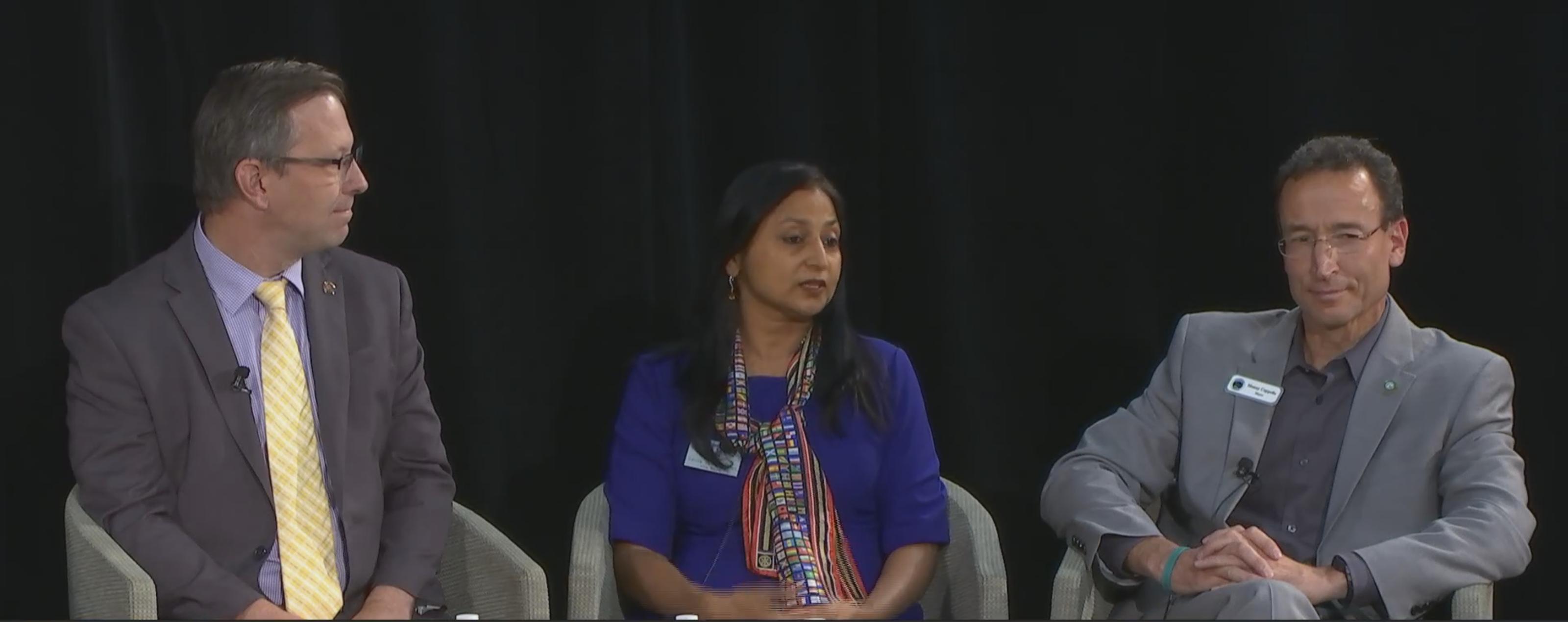 Vice Mayor Savita Vaidyanathan (center) sits next to Campbell Mayor Jason Baker (left) and Saratoga Mayor Manny Capello (right).