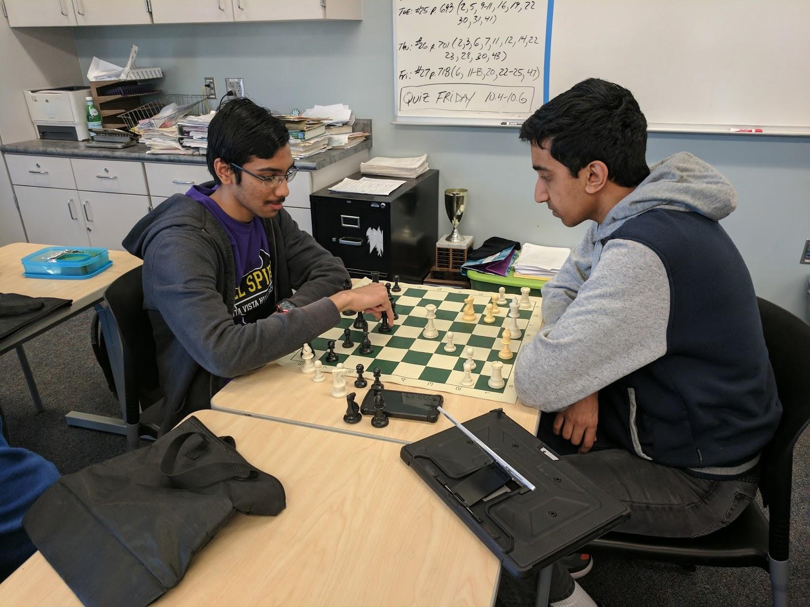 Sophomore Samyak Karnavat (left) and Senior Kesav Viswanadha (right) play a friendly game of chess at lunch while discussing strategy. Practice was a vital part of keeping one's mind sharp and flexible for future games.