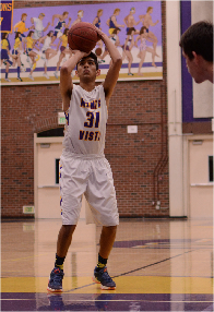 Senior Aditya Mohan attempts a three-point shot in a highly-anticipated rivalry game. The Matadors lost to Lynbrook HS 52-54, ending the season with a 0-12 league record.