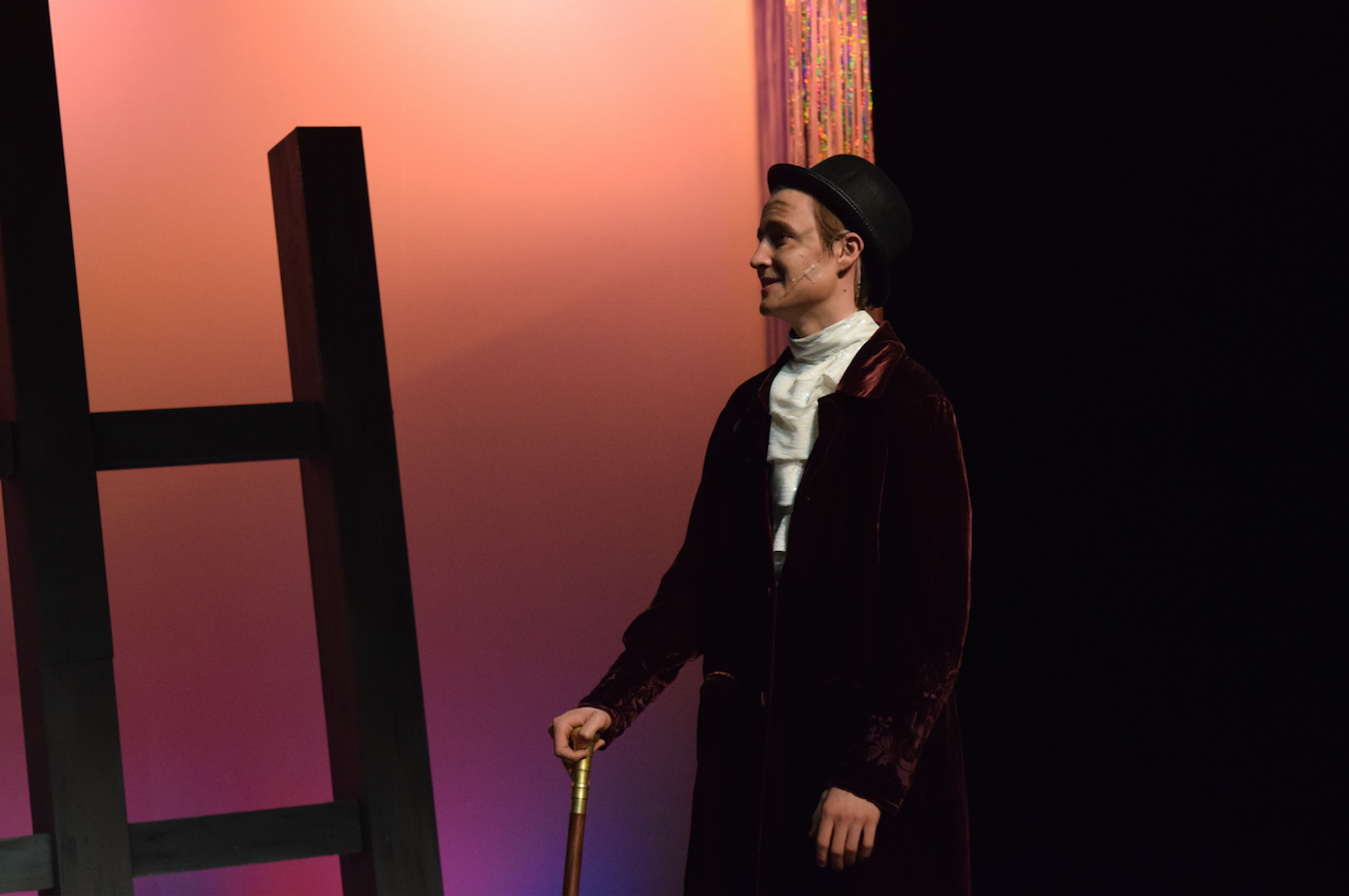 Senior Ben Pribe looks over at senior Jeremi Kalkowski in a scene of the Little Mermaid, the musical this past spring. Pribe played Grimsby, a character that oversaw and mentored Prince Eric, Kalkowski's character. PHOTO | ILENA PENG