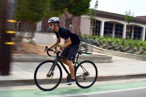 Senior Justin Lin bikes along McClellan Road in front of MVHS. Lin bikes recreationally. Photo by Om Khandekar.
