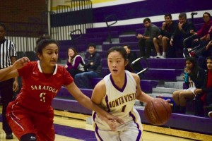 Joyce Chen drives to the basket against an SHS defender. MVHS scored many of their points through layups on fastbreaks. Photo by Shayon Moradi.