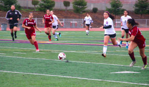 Players run to gain possession after the MVHS goalie kicked the ball back away from the post. Photo by Jasmine Lee.