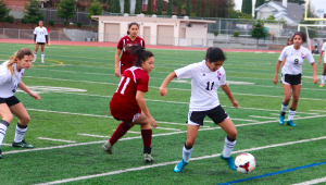 Senior Nanda Nayak slips through the CHS defense. The Pioneers often tried to push the ball to the sideline to penetrate MVHS offense. Photo by Rana Aghababazadeh.