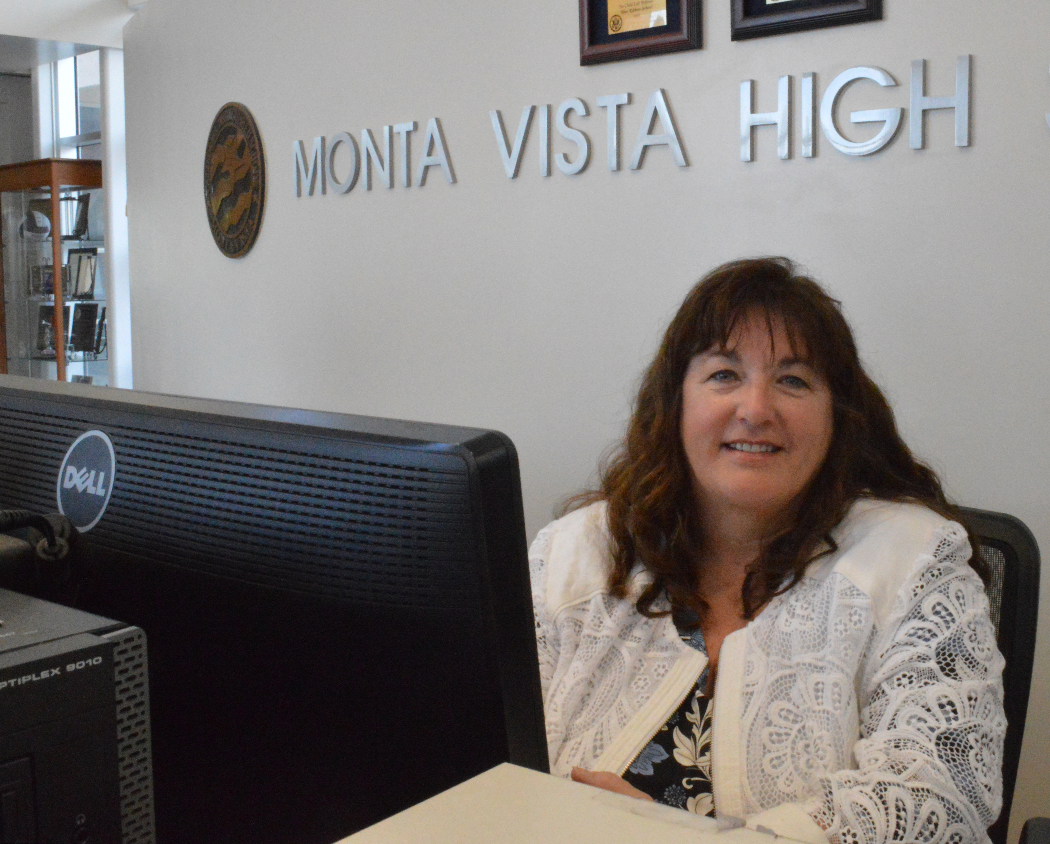 Giarritta poses at the front desk of the MVHS lobby. A staff member at MVHS for two years, Giarritta is the second winner of the 2018 Employee of the Year award. Photo by Maggie McCormick.