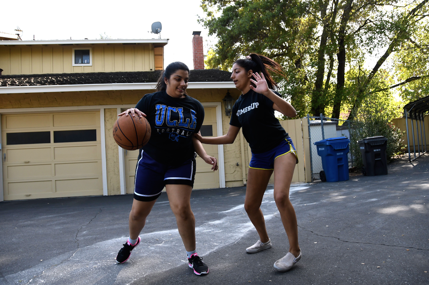 Senior twins Priyanka and Rupali Sujan play one on one in their front yard. They play regularly both for fun and to help each other improve particular skills.