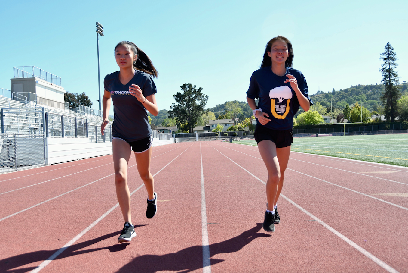 Freshman twins Brooke and Bianca Young run alongside one another. Photo by Roshan Fernandez.