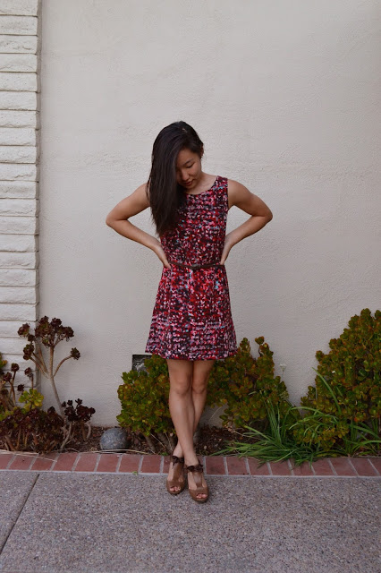 Tong models a watercolor patterned dress. She made this dress herself using a silky fabric. Photo used with permission of Irene Tong.