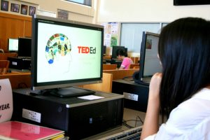 Senior Iris Liu accesses a TED talk at the school library. The iPrism filter, which had previously prevented students from using Youtube and several other sites, has been lifted this year. Photo Illustration by Ashish Samaddar