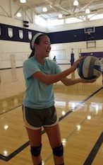 Co-captain senior Beverly Yu prepares to serve the ball during a practice game at tryouts. Tryouts ended on Wed. Aug 21. Photo by Manasa Sanka.