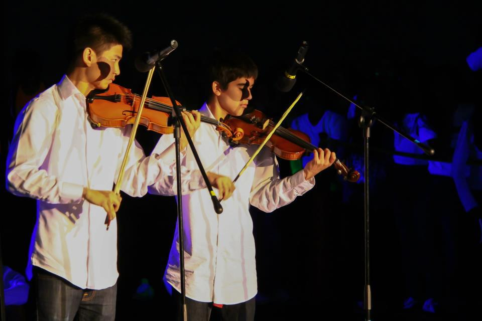Juniors Michael Ligier and Andy Wang perform Britney Spears' 'Toxic' at last year's Blacklight Rally. Ligier and Wang go by the name No Strings Attached, and play popular songs on the violin. Photo used with permission of Clark Lin.
