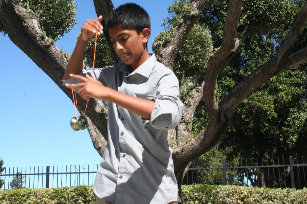 Shaik who recently began learning yo-yo tricks demonstrates a beginner trick. Photo by Catherine Lockwood.