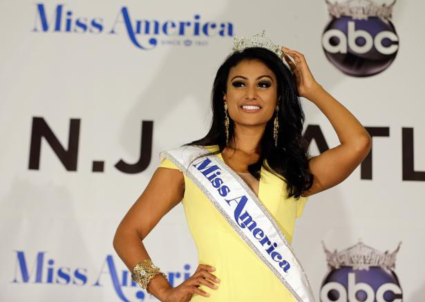 Nina Davuluri, a darker skinned Indian-American woman, accepts her crown at the Miss America 2014 pageant. Davuluri is the first Indian American woman to win Miss America,which upset many people who did not recognize the step  towards race equality. Photo by AP Photo/Mel Evans