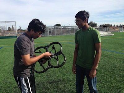 Senior Paras Jain and sophomore Ajay Jain, respectively the club's President and Vice President, look at the quadrotor helicopter, which they displayed at the club's meeting on Jan. 28. A quadcopter is a multirotor device propelled by four rotors. Photo by Varsha Venkat.