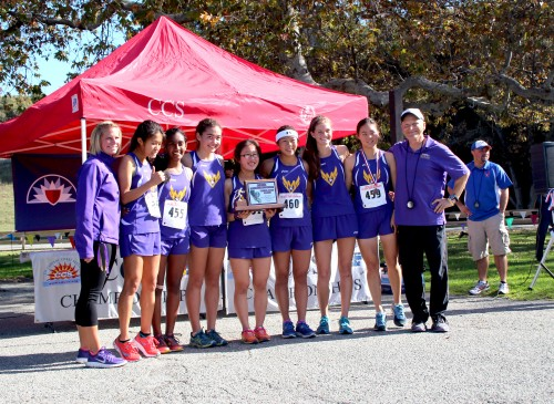 The varsity girls poses with the plaque that they received as the second fastest team at CCS. They will be moving on to the State Championships on Nov. 29. Photo by Sharon Tung.