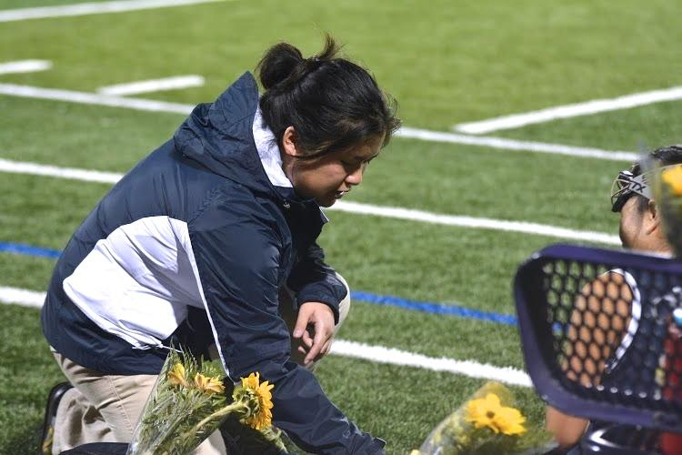 Athletic trainer Marie Gishifu examines a Lynbrook High School field hockey player on Oct. 30. Gishifu attended the game to cheer on MVHS and watch over the athletes.