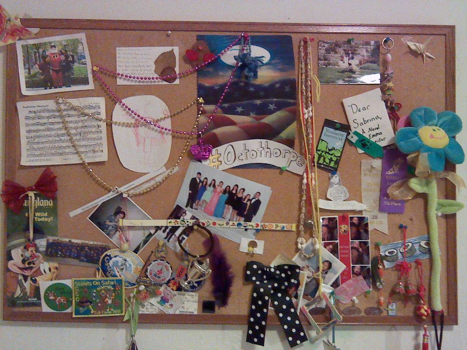 Senior Brina Tsui's bulletin board hangs in her room, displaying different mementos. Souvenirs from trips, gifts from her friends and photos are all displayed on the board. Photo by Brina Tsui.