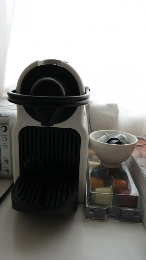 Leung's Nespresso machine sits by the window, coupled with small cups of espresso flavors. Leung drinks a cup of espresso every morning. Photo by Rhonda Mak