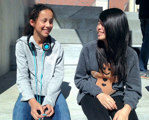 Freshmen Mel Hauradou and Amber Hu sit on the stairs during lunch on Feb. 24. Photo by Avni Prasad