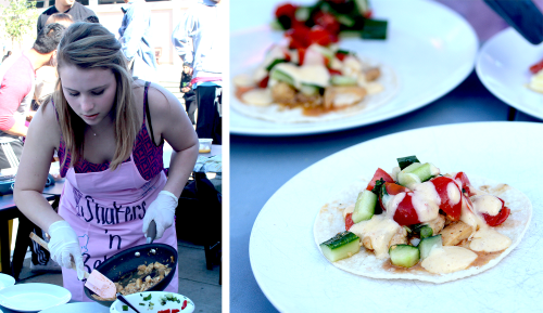 Senior Erin Luks sautées fish and combines it with fresh cucumbers and tomatoes. Her team, Shakers and Bakers, made fish tacos as their healthy dish for the judges to taste. Photos by Justin Kim.