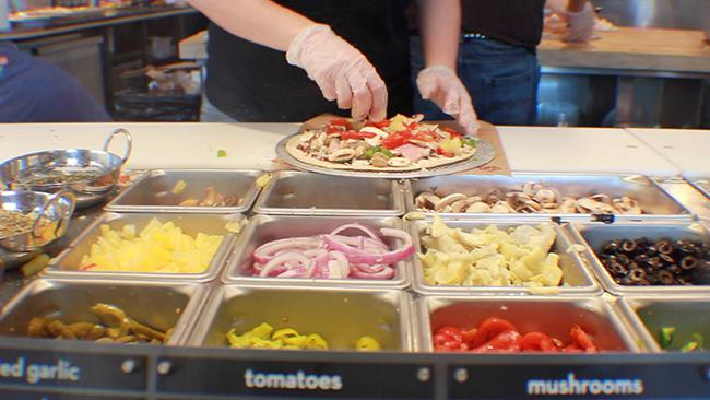 Assembly line at MOD. MOD Pizza is completely customizable, similar to Chipotle.