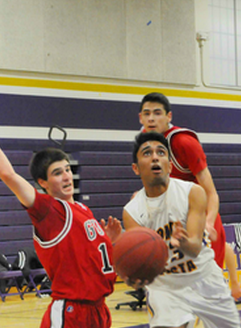 Junior Aunoy Poddar shoots a layup surrounded by several Titans. Throughout the game, the Matadors were unable to get any easy buckets. Photo by Pranav Iyer.