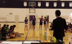 Badminton coach Eric Liu watches as Matadors explain the rules of the Field House to both teams on March 19. The short introduction is customary to most badminton games. Photo by Brandon Chin.