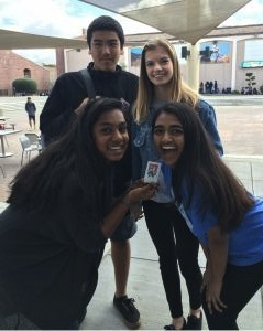 From top, left to right: Freshmen Ehab Risk, Hanna Kotesova, Mansi Reddy, and Neha Jagathesan hold their Polaroid picture.
