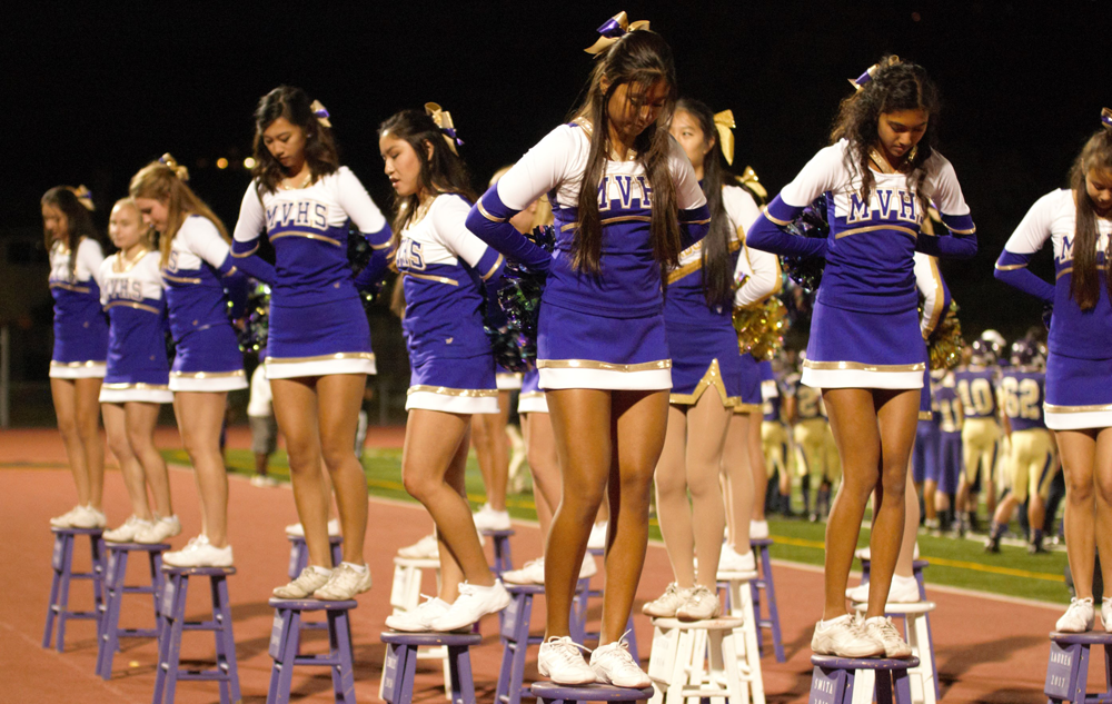 Cheerleaders balance on their stools during the Homecoming football game on Oct.  17.