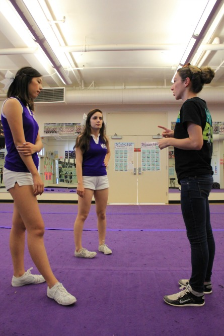 Cheer captains seniors Kelsey Hsing and Mane Mikayelan talk to coach Brittany Carey before tryouts on April 1. When deciding leadership positions, Carey heavily emphasizes academic performance.
