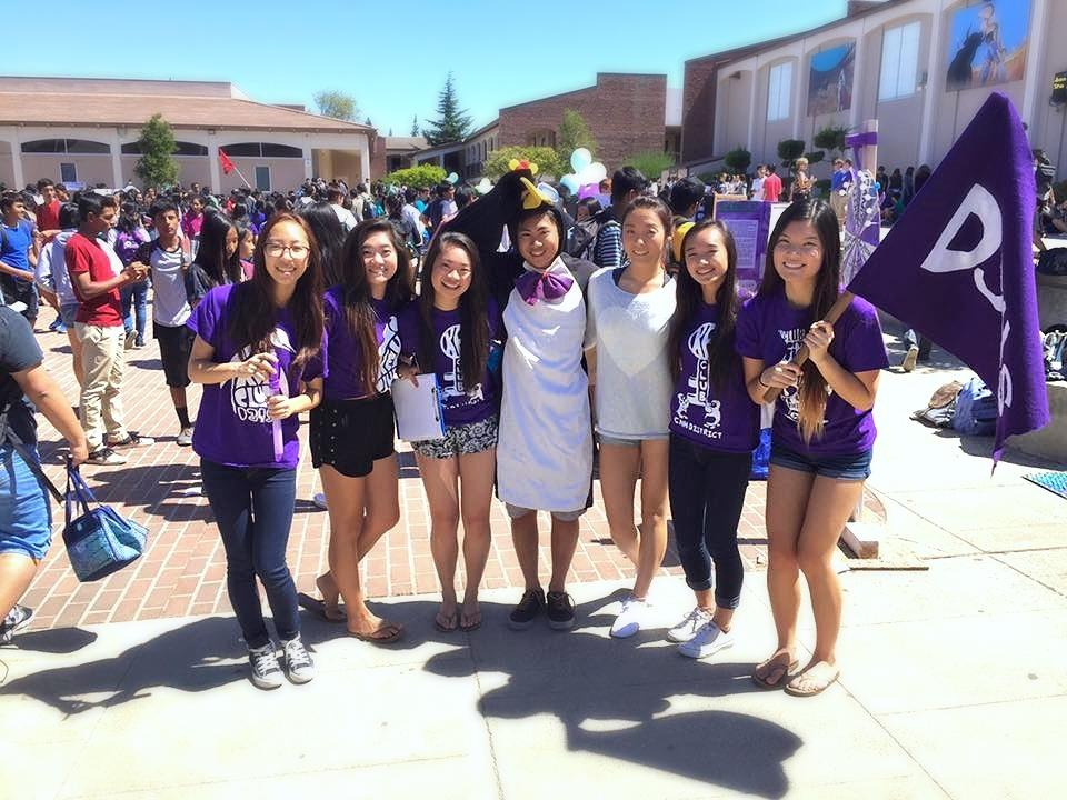 """y Club officers, also known as the """"penguins"""", are decked out in their club shirts and mascot to advertise the volunteer service club. From left: junior Esther Na, director of membership; senior Cindy Li, co-vice president; senior Heidi Wang, co-president; senior Austin Chan, public relations officer; senior Jasmine Zhang, co-vice president; senior Valerie Lo, secretary; and senior Julianna Xie, co-president."""
