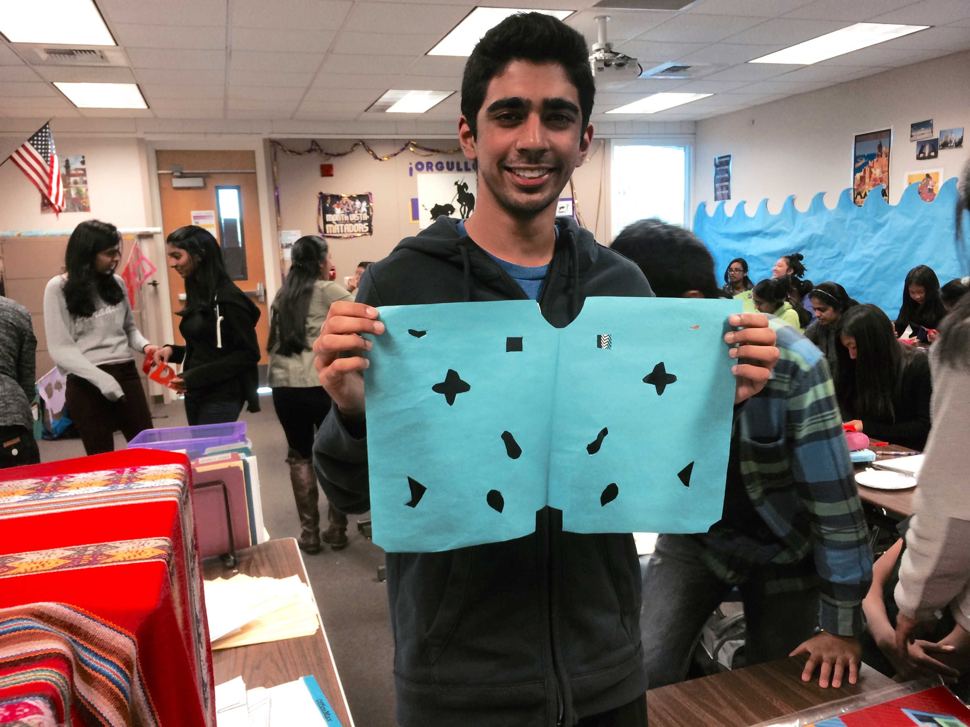 Spanish Honor Society students celebrate El Dia De Los Muertos on Nov. 4. Junior Sid Sharma and other members created papeles picados to decorate the room.