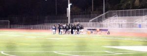 The Varsity Squad standing around Coach Patrick Lowney for strategy breakdown  Photo taken by Justin Kim