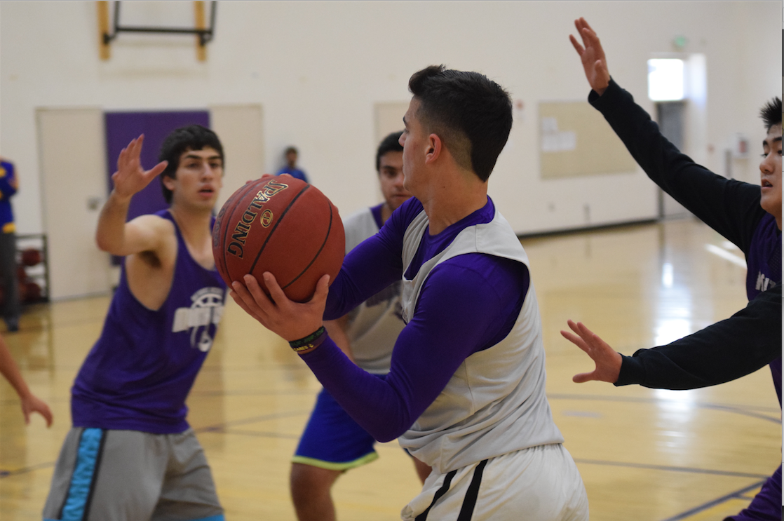 Senior Golan Gingold tries to get the ball around past the defense. The team will look for him, as well as the other seniors, to play a big role in the team's success. Photo by Pranav Iyer.