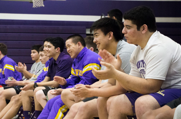 """PA dual meet After a match on Jan. 7, the wrestling team cheered for their teammates. """"The team worked as a group,"""" coach Ian Bork said. """"It's what I like to see, it's what it's all about."""" Photo by Sharon Tung."""
