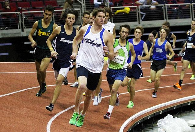 Kevin Bishop runs leads the pack during an indoor state track meet. Photo used with permission of the Cary Bishop.