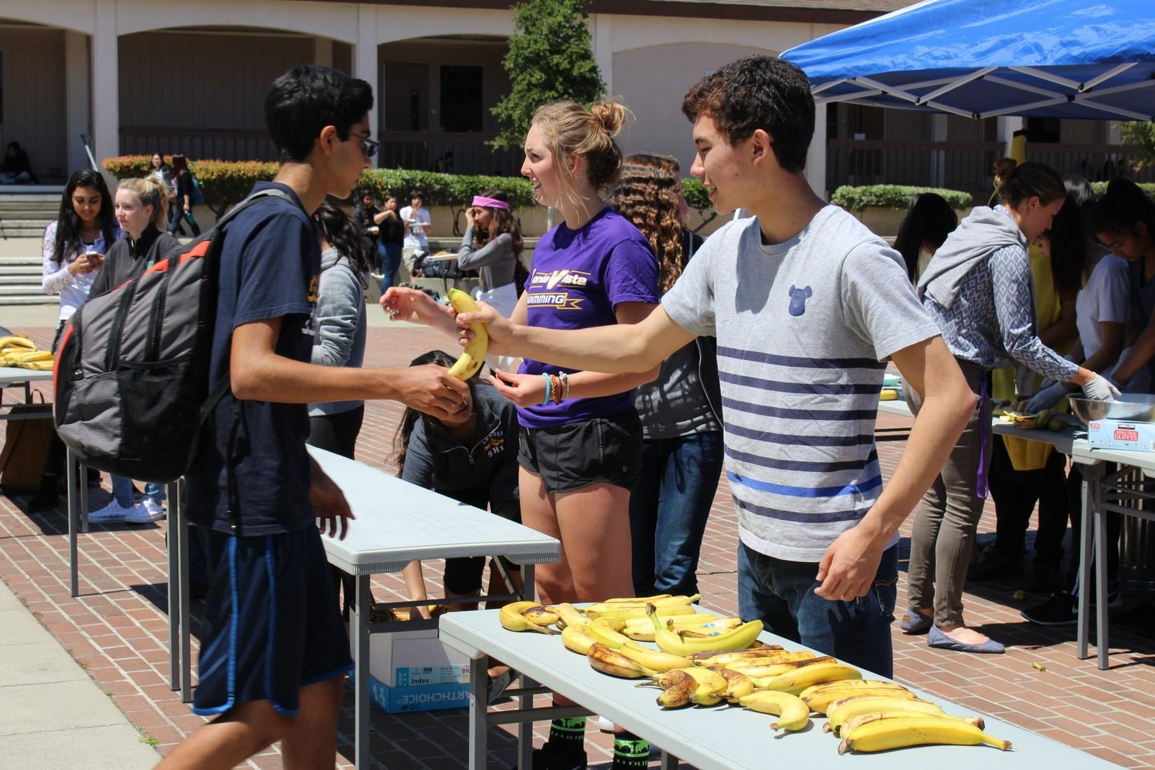 Junior Alex Maertens helped out with the event.The bananas he was collecting from participating students quickly built up as more and more people arrived.