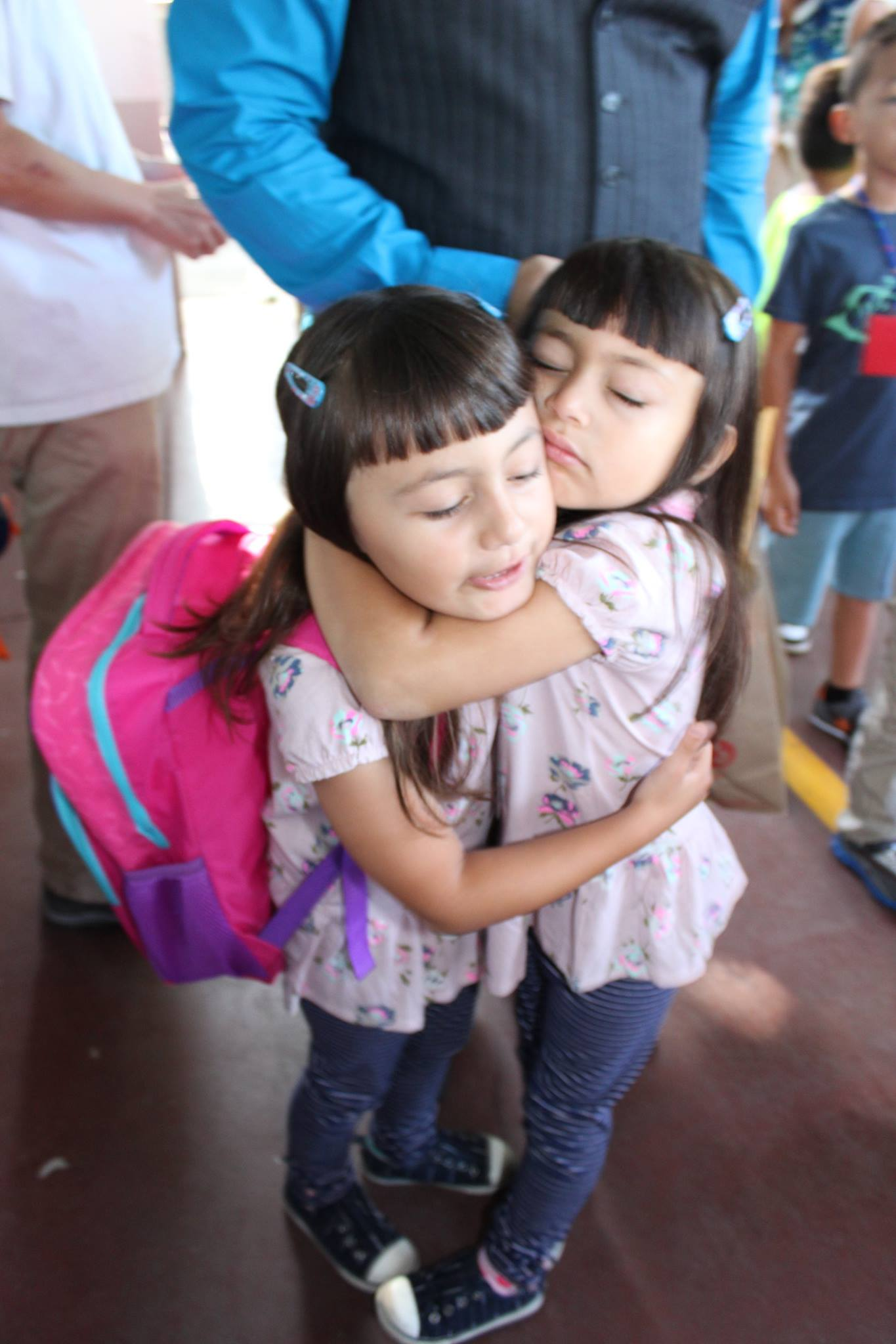 The Otto's twin daughters Elizabeth and Evelyn embrace before heading off to separate kindergarten classes. During their first week at Lincoln, the twins struggled with being apart from one another. Photo used with permission of Vanessa Otto.