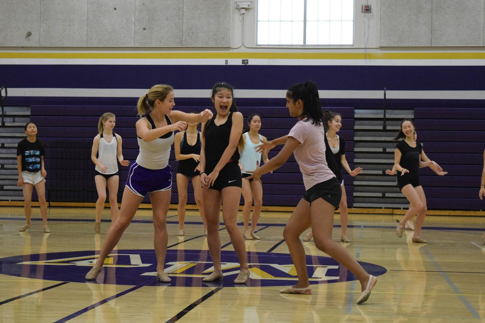 Junior Jessica Kimm and seniors Linnea Cheek and Riona Guha, who is a captain for the Marquesas, rehearse a section of the routine. The humorous choreography gave the Marquesas the chance to show a sense of camaraderie in their team throughout their dance.