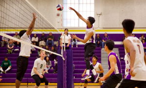 Senior Yash Hegde executes a kill in the fourth and final set.