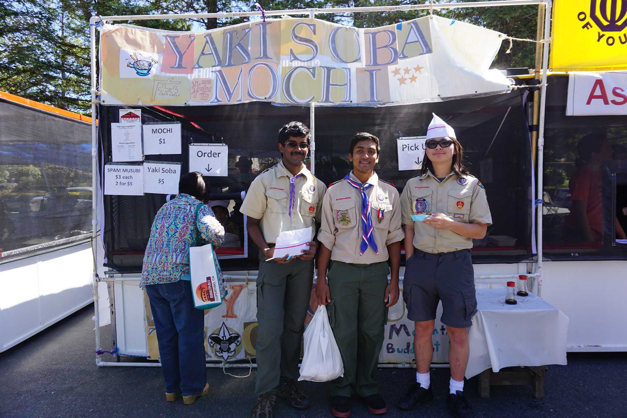 Scouts from Boy Scout Troop 487 stand in front of their Yakisoba Stand. Troop 487 reserves a stand at the Cherry Blossom Festival every year.
