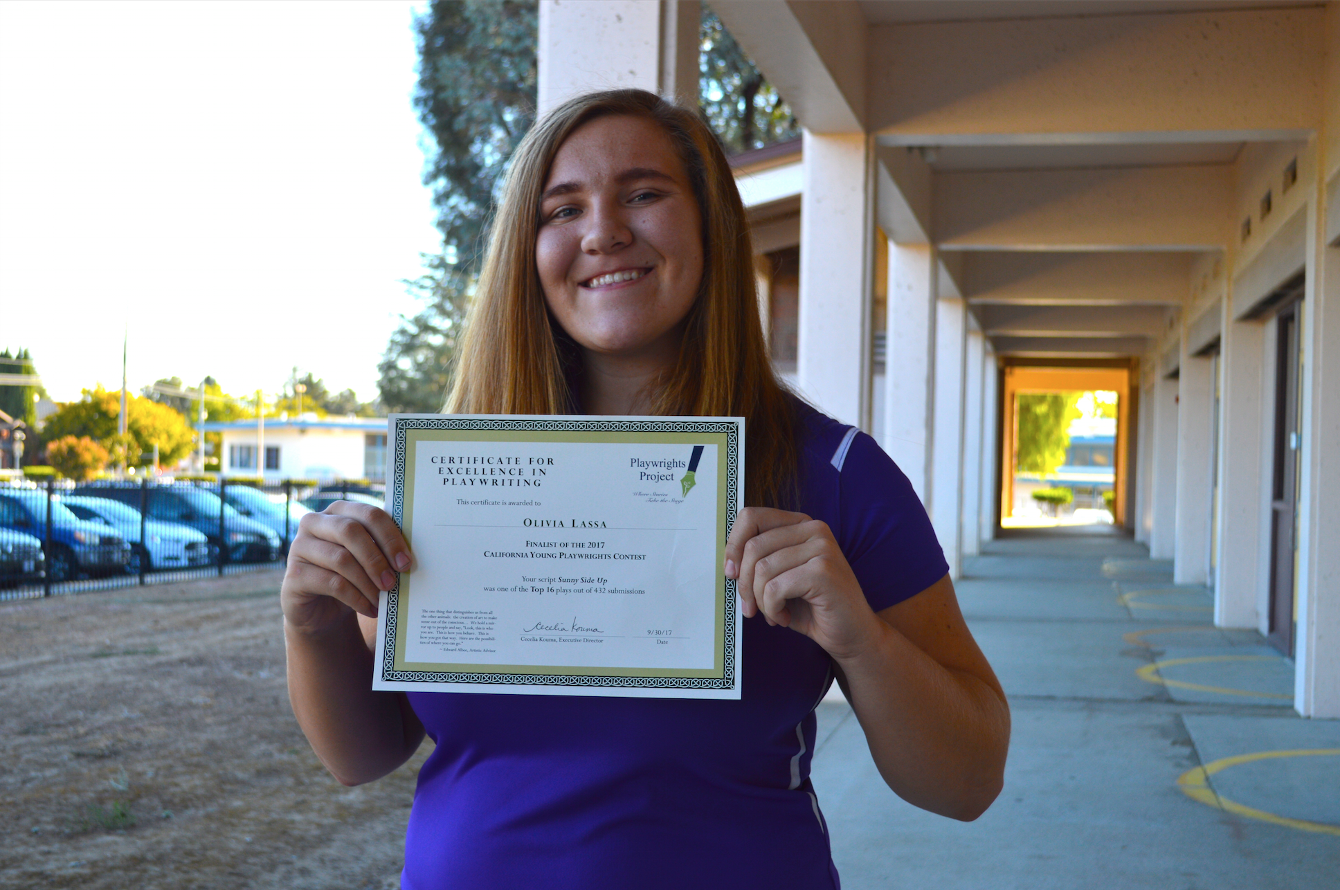 Senior Olivia Lassa holds up her certificate as a finalist in the California Young Playwrights Project. Lassa was one of 17 students recognized by the organization. Photo by Akshara Majjiga.