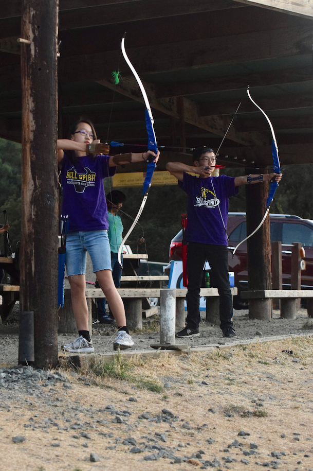 Karesa and David Hui prepare to shoot at the target at Stevens Creek County Archery Range. The twins head up to the range at least once a month. Photo by Roshan Fernandez.
