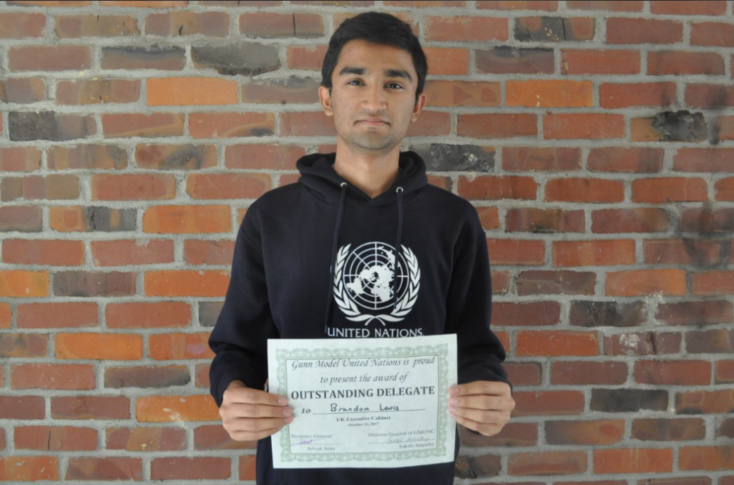 Chandramouly stands with his award. At the MUN conference at Gunn HS Chandramouly received an outstanding delegate award. Photo by Maggie McCormick.