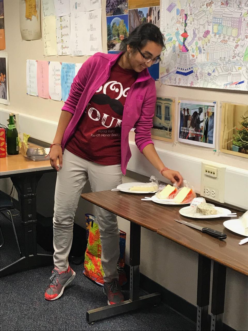 Senior Anika Ramachandran introduces the different types of cheeses. Ramachandran said that FHS' officers had to do research to make sure that all the cheeses were French.