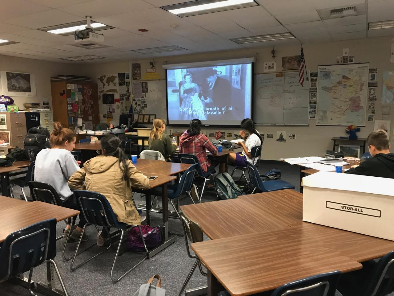 """Students try cheese as they watch """"La Diabolique."""" In keeping with Halloween, which had just passed day before, the movie was a black-and-white horror film."""